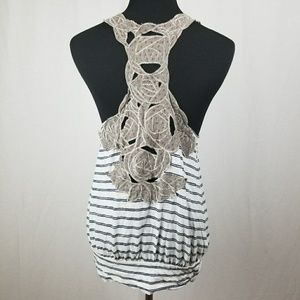 Free people embroidered back tank top size medium.
